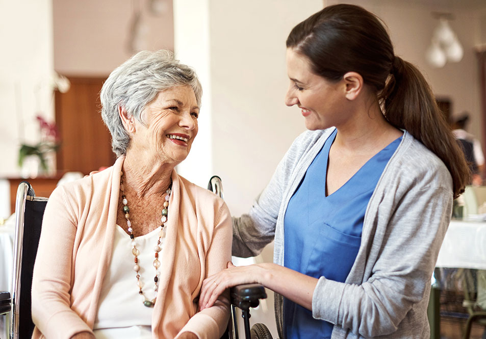 nurse assisting handicap woman