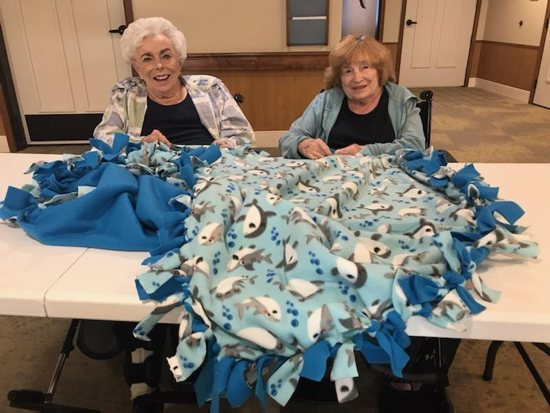 Senior residents, Mary McAlpine and Audrey Betz of Saint Therese of Woodbury, making a blanket to be given to kids - patients at Gillette Children's Hospital.